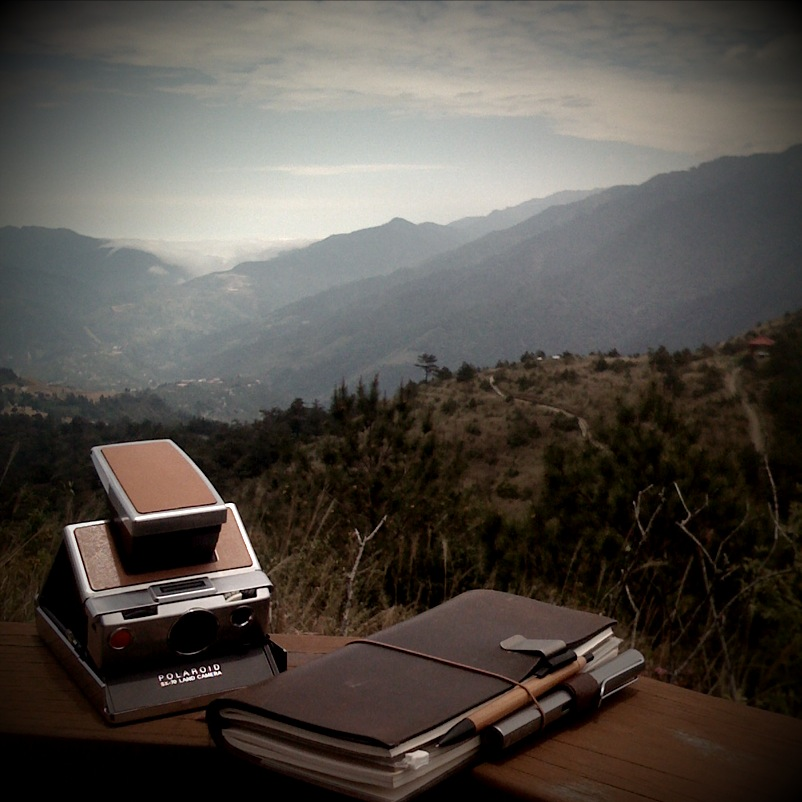 notebook on a rail overlooking trees